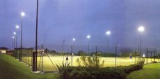 Tennis Courts Lit by Telescopic Flood Lighting Masts